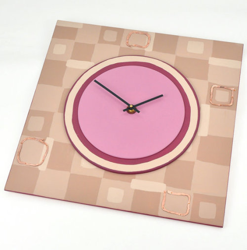 Contemporary meets industrial - large wall clock with hammered copper accents over taupe checkerboard and plum circles.