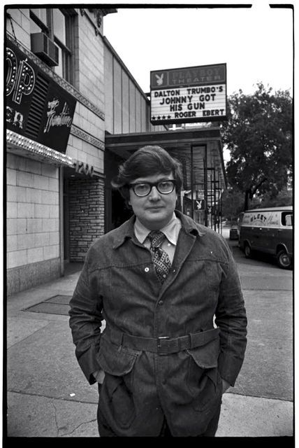 chicagogeek:  R.I.P. Roger Ebert (June 18, 1942 – April 4, 2013) Ebert stands in front of the Playboy Theater (once the Sandburg Theater) at 1204 N. Dearborn, Chicago, ca. 1971. It is now a Walgreens.