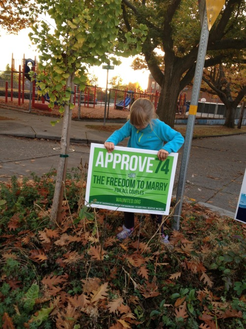 6-year-old Cornelia putting up signs in her neighborhood in support of WA State marriage equality.—AF