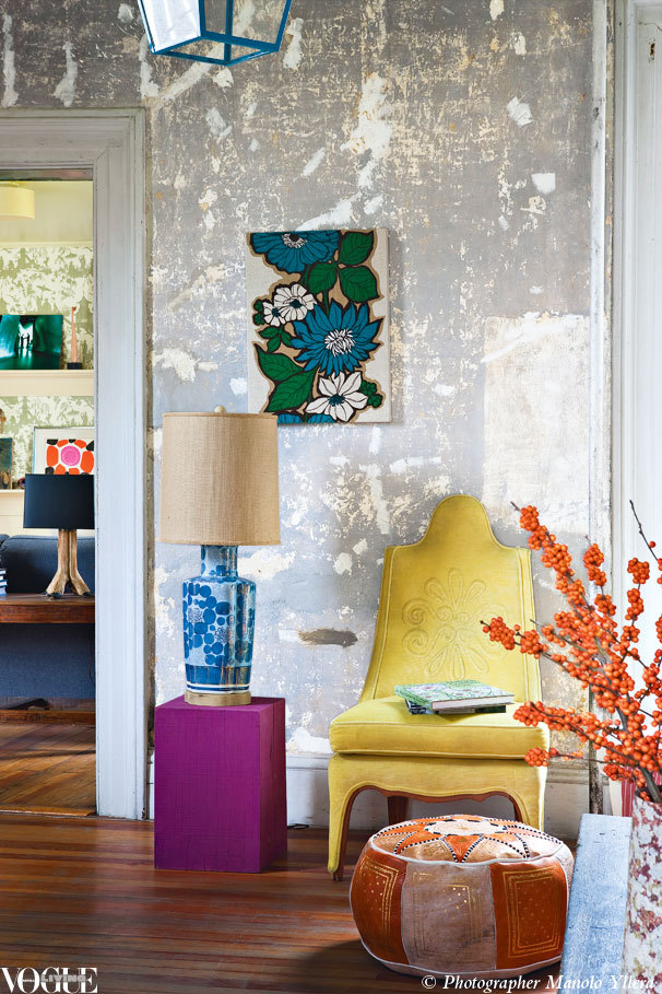 voguelivingmagazine:  A yellow, embroidered chair pops against the rustic wall treatment and blue accessories in this eclectic living room. From 'The Bourne Identity', a story on page 148 of Vogue Living September/October 2012. Photograph by Manolo Yllera.