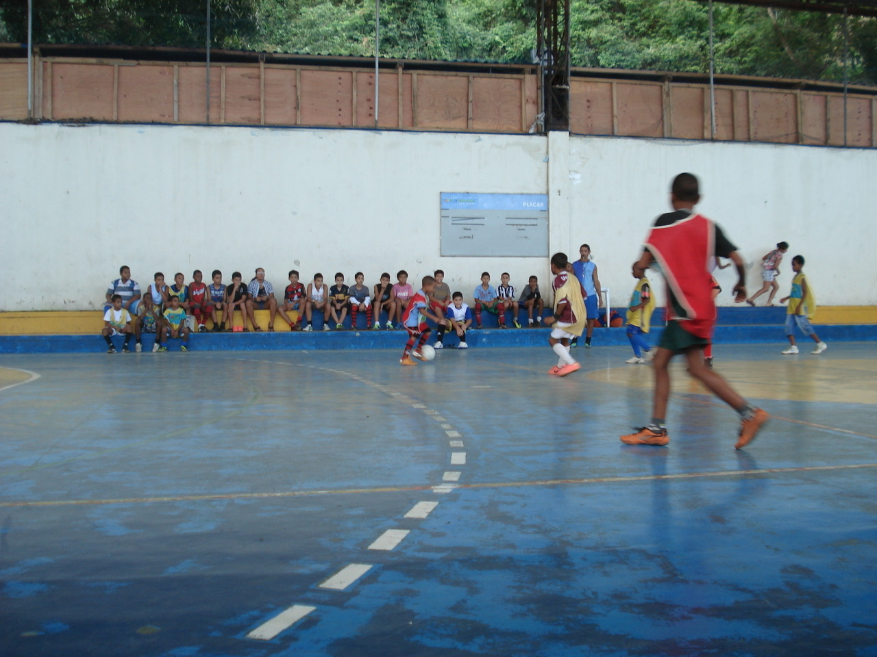 "#WhereIsFootball: The Cantagalo favela, Rio de Janeiro ""This past summer I spent a month in Rio de Janeiro participating in a study abroad program which focused on applied anthropology. Throughout those four weeks we visited a number of community centers located in various favelas throughout the city. This particular photograph was taken in the Espaço Criança Esperança community center in the Cantagalo favela. This center provides kids in Cantagalo with a place to explore books, music, and art, as well as sports such as swimming, boxing, and futebol. Towards the end of our visit we stopped and watched these kids display some pretty impressive skills. Unfortunately that's the only photo I have, wish I had taken more. - Mary Allen""  Thanks for a healthy dose of perspective, Mary. I'm calling this the other, other side of 2014. These kids may not have much, they may be the ones the government is refusing to take care of ahead of the World Cup, but no one will be taking that ball away from their feet. In a poverty-stricken favela, this futsal court will try to support the dreams and the joy of the next Ronaldinho. Get involved with #WhereIsFootball and follow our project on Instagram."