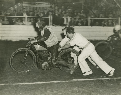 Motor bike racer getting a push start at the track, Brisbane (by State Library of Queensland, Australia)