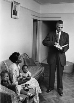 blackandinlove:  Malcolm X with his wife Betty & two of their daughters.