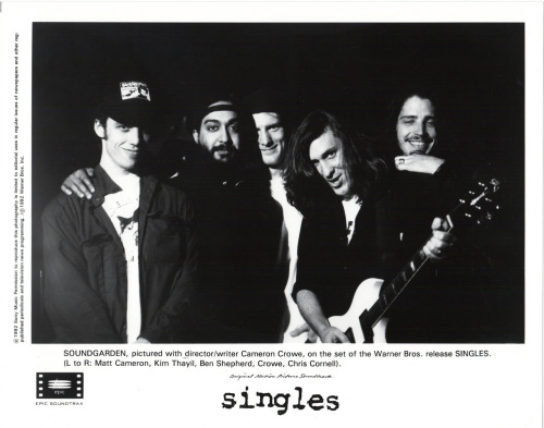 Rare Promo Photo: SOUNDGARDEN, pictured with director/writer Cameron Crowe, on the set of the Warner Bros. release SINGLES. (L to R: Matt Cameron, Kim Thayil, Ben Shepherd, Crowe, Chris Cornell). (From the collection of Gianluca Giangio Sirri)Previously: Alice in Chains Singles promo photo