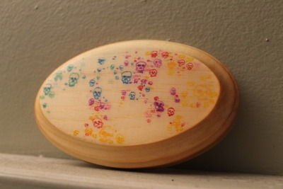 "Rainbow SkullsBy Mike Boston Dr. Ph Martins Watercolors on 5"" oval wood panel with glossy resin varnish. Buy it HERE"