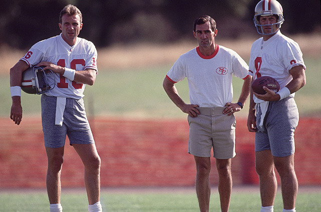 San Francisco quarterbacks Joe Montana and Steve Young huddle with offensive coordinator Mike Shanahan during a training camp session in 1992. This year's 49ers squad has its own QB dilemma - Colin Kaepernick vs. Alex Smith. In his latest column on SI.com,  Don Banks says there is a precedent for a teams winning the Super Bowl after switching quarterbacks midway through the season. (Peter Read Miller/SI) BANKS: Opinions split on Kaepernick move, but history backs HarbaughGALLERY: San Francisco 49ers Glory Years