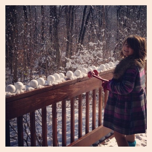 Lining up her snowball arsenal. #project365 11.28.12