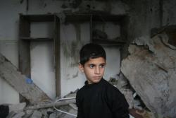 unicef:  Hussam, 11, surveys the remnants of his damaged home, in the city of Rafah, in the Gaza Strip. Children throughout the region struggle to cope after the violence. UNICEF and its partners are working hard on emergency projects to get children back to class, despite damage to more than 136 schools and kindergartens. We're also providing health services, water, sanitation and psychosocial support to children. © UNICEF/2012/Iyad El Baba http://www.unicef.org