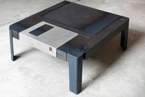 parislemon:  laughingsquid:  Floppy Table, A Wonderfully Designed 3.5″ Floppy Disk Coffee Table  I once cut my thumb down to the bone with one of these. (The disk, not the desk.)