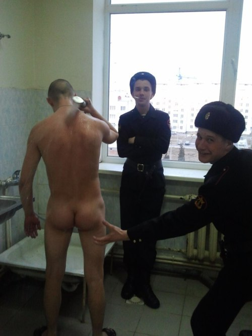 Straight Russian army cadets keeping their buddy company while he is showering.
