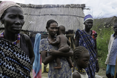 "Photo: Residents of Gumuruk village in Jonglei State return to their homes after spending a month fleeing violence in the bush. South Sudan 2012 © Robin Meldrum/MSF South Sudan: Displacement and Destruction of Health Facilities in Jonglei State Ongoing violence in South Sudan's Jonglei state has had a devastating impact on tens of thousands of people, with many forcibly displaced and further cut off from health care due to the destruction of medical facilities. While Jonglei state has a long history of intercommunal cattle-raiding, thousands of civilians, including women, and children as young as four months old, have been caught up in violent attacks since 2009, which usually occur during the dry season. A disarmament campaign begun in mid-2012 led to widespread insecurity and was accompanied by abuses against civilians. Further fighting in Jonglei between a militia group and South Sudan's armed forces has compounded the violence, causing new displacements at the height of malaria season. Health care is threatened as medical facilities are targeted and destroyed. ""Patients arriving in MSF clinics seeking treatment for injuries describe how they have been forced to make devastating decisions about which children to flee with and which children to leave behind,"" said Chris Lockyear, MSF operational manager. ""What we are seeing is an emergency; the lives and health of Jonglei's population are hanging by a thread. The dry season is now upon us, making movement around the area possible again, and we fear a further spike in violence, injury, and displacement."""