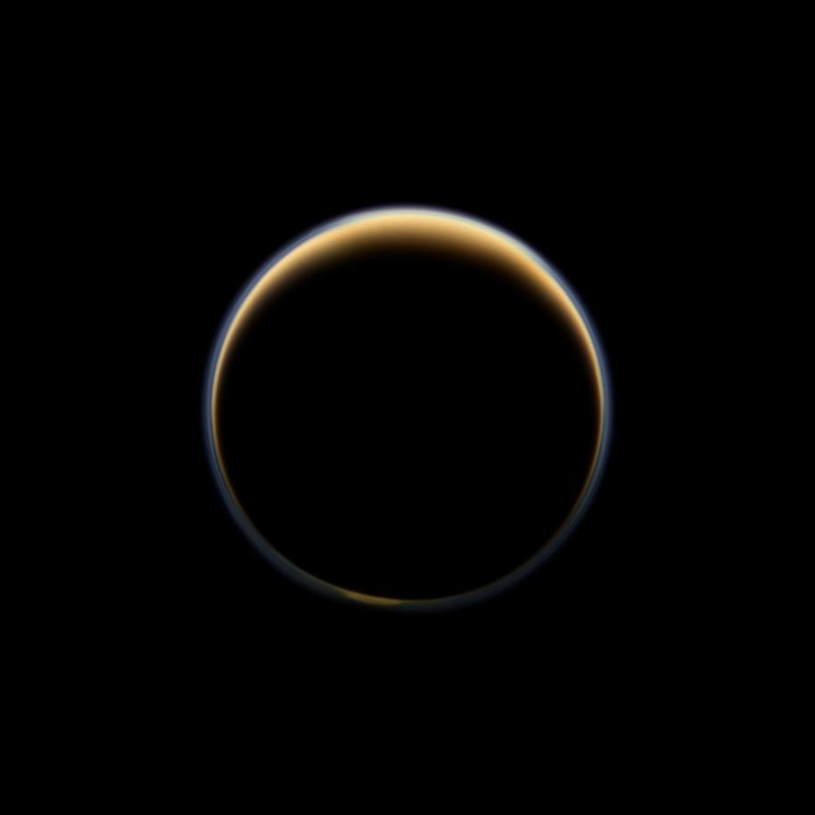 ikenbot:  Saturn Moon Titan's Atmosphere Shows Surprising Rise  Saturn's cloudy moon Titan has a middle atmosphere containing organic compounds that could hold the potential for life. Now, a new look at that atmospheric layer by a NASA spacecraft shows that it may be on the move, scientists say.  Image: This night-side photo of Titan taken by the Cassini spacecraft shows a buildup of haze over the Saturn moon's south pole (bottom). New results from Cassini's infrared spectrometer show that air is now sinking at the south pole, leading to increased temperatures at high altitude and a large enrichment in trace gases. Image released Nov. 28, 2012. Credit: NASA/JPL-Caltech/Space Science Institute  New measurements from NASA's Cassini spacecraft orbiting Saturn show that the seasonal movement of the trace atmospheric gases on Titan rises to higher altitudes than expected, researchers said.  Because of Titan's seasonal orientation, the winter poles always point away from Earth, hiding on the moon's dark side. Studying the complex trace gases in the visible summer hemisphere doesn't solve the problem; water vapor in Earth's atmosphere obscures the measurements of the trace gases.