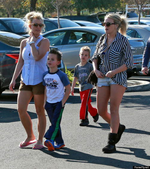 I've been looking at this photo of Britney and Jamie Lynn Spears walking through a parking lot for three uninterrupted minutes just drinking in every detail like precious nectar. The slight strain of her buttons in the tit area, Older Son's nearly-too-small tee, the angle of Britney's right ear. It's art. Riveting art.