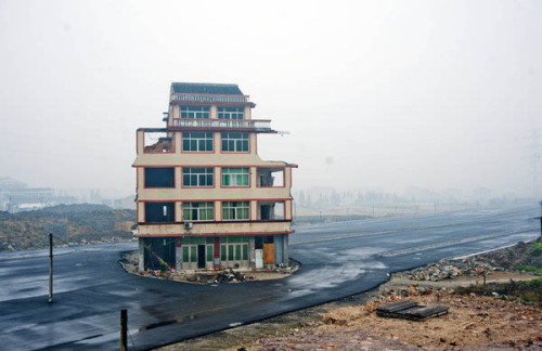 good:  The Last House Standing: A Family in China Refuses to Move for Construction  This is what it's like to live in the middle of a highway. When the government told them to move out, this elderly couple refused to leave their home, saying they weren't being fairly compensated.  Thanks, Adele