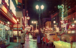 memoriastoica:  Rainy night on SW Broadway, south from Washington Street, in the 1950s.