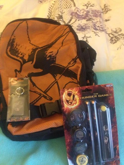 ladys3:  My prizes for winning Mockingjay.net's costume contest came in! I had actually forgotten there were prizes. This is awesome!