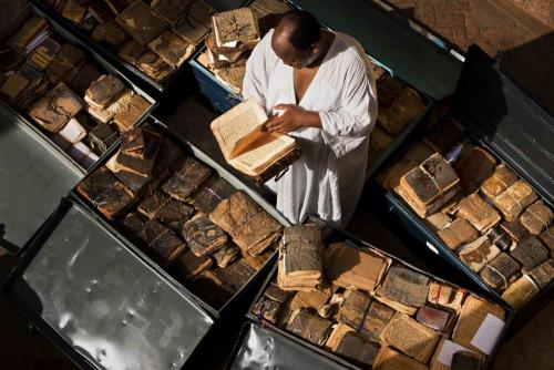 cosmicyoruba:  kimtrelletheonly:  Ancient manuscripts from Mali, Niger, Ethiopia, Sudan and Nigeria line storage cases at Abdel Kader Haidara's home, the director of Bibliotheque Mama Haidara De Manuscripts, Timbuktu. These manuscripts are waiting their turn to be cataloged and added to the library collection. Inside them is a history of Africa from the 11th century onwards, with dialogue on Islam, trade, history, the law and so on. Image by Brent Stirton, National Geographic, September 2009. Article from pulitzercenter.org