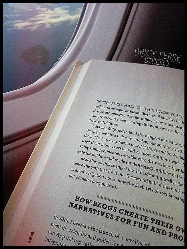 "I love reading a good book when I'm flying. This time, my partner for the trip is ""Trust me I'm Lying"" (Confessions of a media manipulator) by Ryan Holiday. I heard about that book while watching one of Chase Jarvis's latest CJ Live. To quote Chase: ""Ryan is a media genius who hires and fires creatives–photographers, filmmakers, designers and more people just like us– AND he promotes, inflates and hacks some of the biggest names, celebrities and brands in the world. Ryan Holiday is all these things, he's also the Director of Marketing for American Apparel, and he's just 24 years old (yes you read that correctly – he took the job after he turned legal drinking age…). Mind blowing responsibility and million dollar budgets, plus the brains behind all those risque American Apparel ads you've seen…. Want to know all his secrets? How to create content that gets noticed? How to get hired as a creative? How to get your name in lights? And then hack the system to get results? It's more than you think, and it's not all fun and games."" Definitely a good read in my opinion if you are a creative and you are trying to get your work out there. Email Us / Check my Portfolio / Follow me on Facebook / Follow me on Twitter / Follow me on Instagram /"