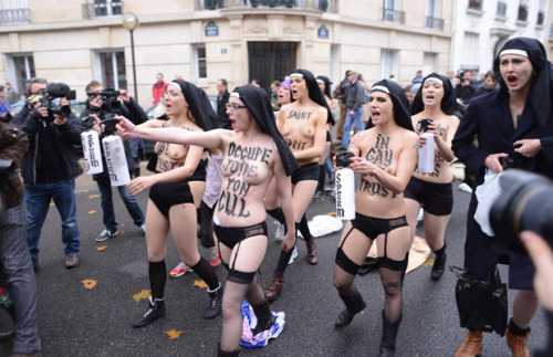 amandapalmer:  (NSFW) a catholic group in france is suing pro-gay fake nuns for counter-protesting an antigay hate rally…while topless. naked nun performance art FTW. (via @neilhimself's twitter) full articlehttp://j.mp/TmlFgh