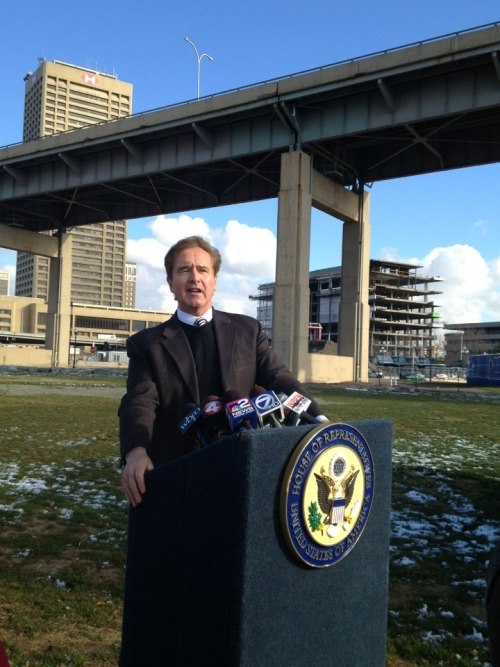 whatsnewbuffalo:  Revitalization: DOT Agrees to Look at Skyway Alternatives Congressman Higgins stands in front of his towering opponent while inner harbor development can be spotted in the background. The Skyway has stymied harbor development for years and now finally NYSDOT has agreed to look at alternatives to the concrete behemoth. Alternatives include South Park Ave since it's $2.3 million improvements as well as Ohio Street, undergoing an $11 million transformation into a riverfront parkway, or a potential bridge connecting the inner and outer harbor. If Higgins succeeds the waterfront would be free from under the Skyway's shadow allowing a more tourist-friendly waterfront.   Yes please. Down with the skyway.