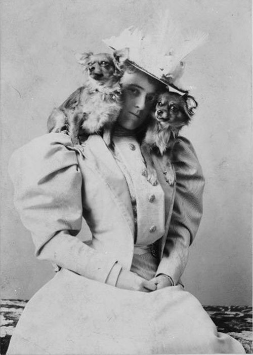 explore-blog:  Quite possibly the best author portrait ever: Edith Wharton with her two pups, (1889) and other portraits of writers with their pets. For more literary-canine love, complement with The Big New Yorker Book of Dogs.