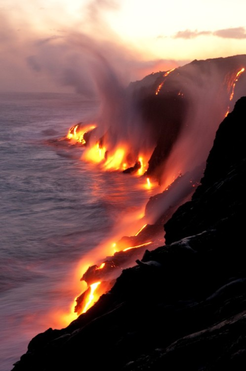 "beautiful-places:  Elements ""Starting at Kalapana, Hawaii I walked for two hours right to the place on the coast where active lava flows were touching the ocean. I was overwhelmed about the scene: Hot air touched my face as I stood at the edge of the cliff, steam drifted away by the strong wind, thunders in my ears as the waves crushed on the melted stones and water fought with fire. I stood and watched the lava flows started to glow as it became darker. I wanted to express what happened there. All four elements – water, fire, air and earth came together at that point to show how they're playing the game. — Jennifer Vahlbruch"