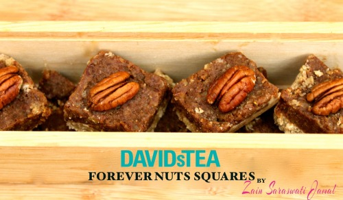 Zain's Forever Nuts Squares *featuring DavidsTea* (Raw & Vegan)  The perfect handmade Christmas gift!!  For those of you familiar with DavidsTea brace yourselves because this recipe is about to blow your minds.  This decadent and delicious raw, vegan recipe is made with my all time favourite tea in the whole wide world…Forever Nuts! Chalk full of nutrients, omegas and healthy proteins, this sweet treat recipe can be added to your list of handmade gifts to give away in tins or boxes…after all, why not give the gift of health to your family and friends rather than a box of sugary cakes & cookies. You'll be amazed at how easy these are to make and the best part is…you don't even have to turn on your oven! Ingredients: Crust Layer 1 Cup Ground Uncontaminated Oats (OR Almond Flour) 2 Tbsp Sunwarrior Protein Powder OR Vegan Protein Powder of Your Choice (whey, brown rice, pumpkin seed etc) - Optional 2 Tbsp Extra Virgin Coconut Oil (if using protein powder, add another 1/4 - 1/2 oil until the crust clumps) 25-30 Drops Vanilla Creme Stevia OR Sweetener of Your Choice (2 Tbsp Maple Syrup works great here too!) Pinch Pink Himalayan Crystal Salt Forever Nuts Layer 1 Cup Medjool Dates (soaked for at least 2 hours, I soak mine overnight) 1 Cup Pecans 1/2 Cup DavidsTea Forever Nuts (strongly brewed) 2 Tbsp Maca Root Powder - Optional 1 Ripe Banana 2 Tsp Natural Vanilla Extract 1 Tbsp Cinnamon 1/8 Tsp Nutmeg Pecans OR Nuts Of Your Choice to Top (optional) Directions: 1. In a food processor, blend all ingredients for Crust into a dough-like consistency. 2. Pat crust into an 8 X 8 inch square non-stick pan. 3. In a food processor, blend all ingredients for Forever Nuts Layer until thoroughly combined, scraping down the sides if necessary (if the consistency is too liquidy add another 1/4 cup pecans). 4. Using a spatula smother ForeverNuts Layer over the Crust Layer. Level off with a spatula or spoon to even it out. 4. Top with pecans or nuts of your choice, if you wish, and freeze for at least 3 hours (I freeze mine overnight) 5. Remove from freezer and cut into squares