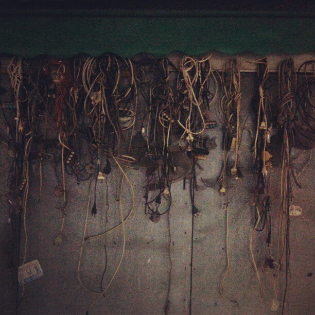 Low contrast version..electric cables stored outside shop: Nammun market, Daegu #daegu #Korea #asia #electric #socket #cable #cord #plug #flow #wire #old #dark #green #thursday #night #market #outdoor #random #urban #cityscape #city