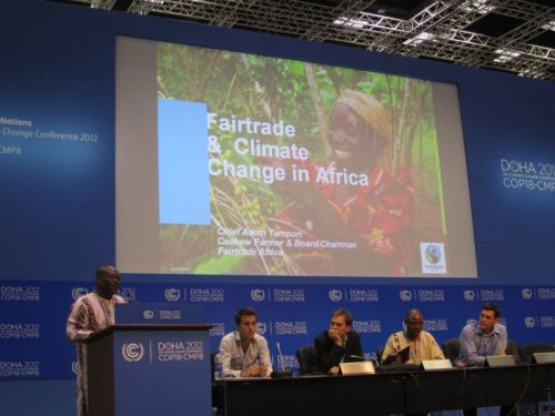 Fairtrade farmer and Chair of Fairtrade Africa, Chief Adam Tampuri speaking at a COP18 side event.  In my village we are feeling the effects of the changing climate. We are seeing strange pests we have never seen before. Just before I came here I lost 50 cashew trees on my farm due to storms, and there is more flooding throughout the year.  We used part of our Fairtrade Premium to embark on some adaptation projects such as acquiring drought resistant seedlings and renovating our houses and roofs to deal with the deluge of rainwater. We have come so far and implemented so much in our village since we became Fairtrade certified.  We don't want to see it all washed away by the rain.   At COP18, Fairtrade producers are calling on world leaders and decision-makers to ensure the most vulnerable get the support and finance they desperately need to adapt to the growing impact of climate change on their farms and communities. Read their statement here