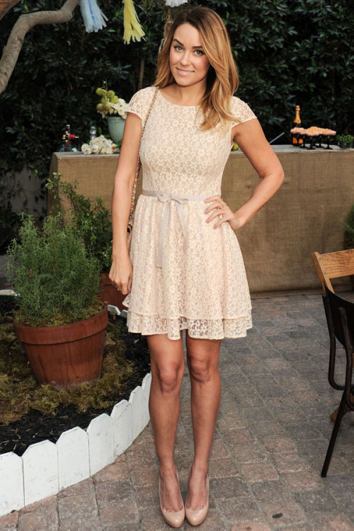 Style star Lauren Conrad looks sweet in a lacy frock (tied with a bow!) and elegant nude Christian Louboutin pumps. Learn more about her look here »