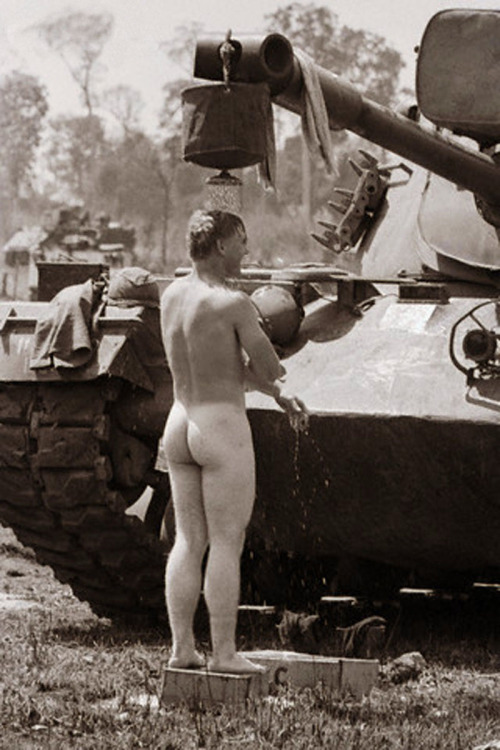 vietnamwarera:  A soldier of the 11th Cavalry takes a shower during Operation Junction City, 1967.