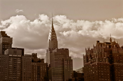 "The Chrysler Building and New York City skyline.  This is a favorite view of the Chrysler Building. In truth, the Chrysler Building is my favorite skyscraper in New York City. I have always loved the art-deco architecture of it's spire and how its needle pokes out above the other skyscrapers that populate the New York City skyline in midtown Manhattan.   This particular view is looking west towards Manhattan and sitting in the foreground are the skyscrapers of Tudor City: neo-gothic historic buildings that lay their claim to fame for being part of the first residential skyscraper complex in the entire world.    —-  View this photo larger and on black on my Google Plus page  —-  Buy ""The Chrysler Building and New York City Skyline"" Prints here, email me, or ask for help."