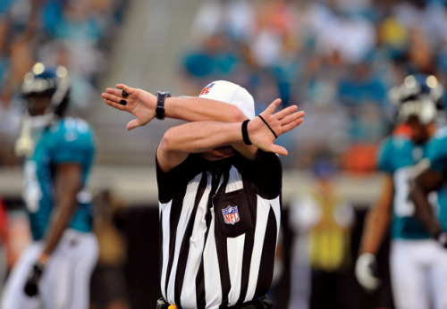 "In Their Own Words: The Replacement Refs What did it actually feel like to go from total obscurity to blowing your first NFL whistle to realizing ""WOW, this is real"" to getting terrorized by enraged coaches and 300-pound linemen to becoming a national punch line to returning to total obscurity—all in just three short weeks? Nathaniel Penn sits down with six replacement refs (including a couple who worked the infamous Seahawks-Packers game) and gets an earful:  Elliott: In the replay booth, you could definitely see the Green Bay guy controlling the ball first and the Seattle guy getting his arms in there, and it was an argument for a simultaneous catch. The replay guy said, ""We're gonna have to go with 'The play stands.' "" I never knew life could be the way it was for the next week. I got, I would guess, 2,000 calls and texts on my cell phone from Wisconsin: ""The best call you could make right now would be suicide."" Peek: For probably three hours of that game, we had been doing a bang-up job, in my judgment. We wanted to bowl a 300 game. We got close to that 300 game, and then, in the last frame, we threw a gutter ball. Brasuell: At San Francisco during halftime, when the security guys stepped out and faced the crowd, I said hi to one of them. He asked how I was doing, and I said I was thankful and blessed to be here, and he said, ""Amen to that."" That had a huge impact on me. If the seven of us officials weren't doing this, this man is out of work. It was a lot bigger than football.  Read the Full Piece at GQ.com"