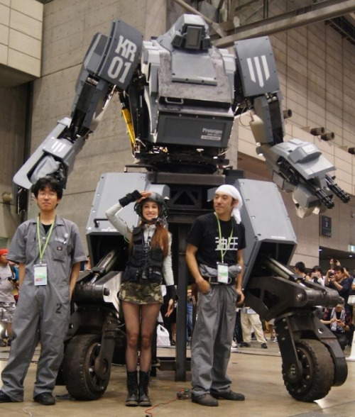 "This 4.4 ton, 14-foot-tall weaponized mech warrior is a thing that you can actually buy now in Japan.   Equipped with a water-powered bottle-rocket launcher, and a ""smile-activated"" machine gun capable of firing 6,000 bb's per minute, one can easily imagine the evolution of the Kurata into a fearsome military monstrosity. With a top speed of 6 mph, the Kurata can either be piloted from inside its cockpit, or remotely — using a smartphone.  ""The vehicle of everyone's wildest dreams,"" as the company boasts in a promotional video, can be ordered in one of 16 different exterior colors, and carries a not-so-humble price tag of $1.35 million.  Watch it in action here."