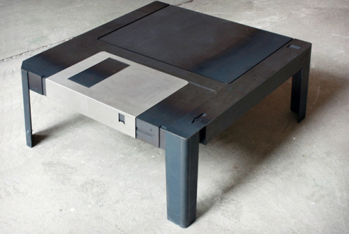 The Floppy table! inspirezme:  Was there anything more entertaining as pulling back that metal slip on a floppy disk and letting it fling shut? This Floppy Disk Table will remind you of the good old days whenever you sit down in front of your TV. Slide the disk cover back and you've got some storage for remotes and coasters. You can buy one here if your inner geek is urging you to do so.