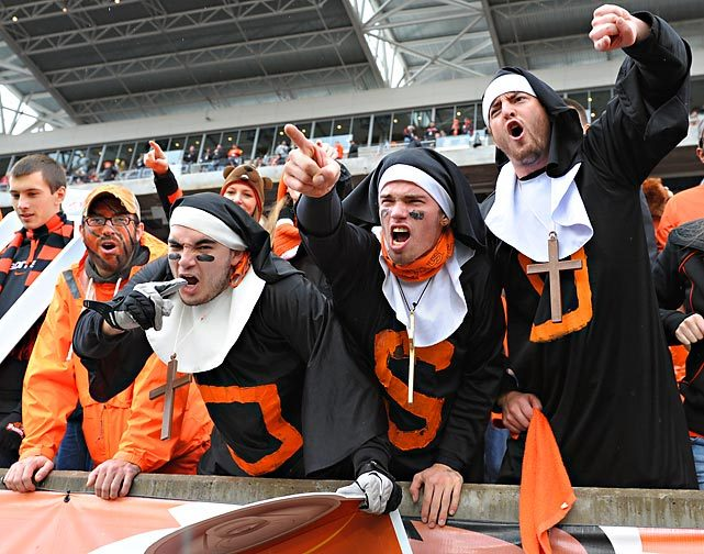 Oregon State fans are overcome with religious fervor during Saturday's Civil War game between Oregon and Oregon State. The Ducks won 48-24. (Brian Murphy/Icon SMI) GALLERY: Did You See That?