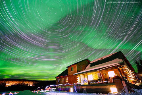 ikenbot:  A Night in Alaska  Northern stars trail around the celestial pole in this long exposure photo sequence from Fairbanks, Alaska.  The night sky at this far north latitude is very often dominated by dancing aurora. TWAN photographer, leading an aurora viewing tour, has captured the motion of stars, northern lights, and his group in this image. — Yuichi Takasaka