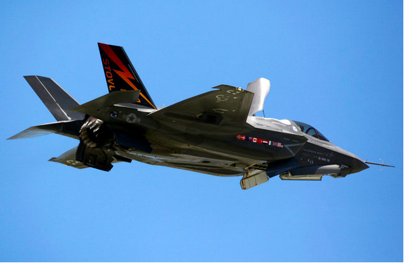 """The F-35 Joint Strike Fighter, which represents the Pentagon's largest weapons program, was supposed to be the arms program that broke the mold, proof that the Pentagon could build something affordable, dependable and without much drama. […] The F-35 was conceived as the Pentagon's silver bullet in the sky — a state-of-the art aircraft that could be adapted to three branches of the military, with advances that would easily overcome the defenses of most foes. The radar-evading jets would not only dodge sophisticated antiaircraft missiles, but they would also give pilots a better picture of enemy threats while enabling allies, who want the planes, too, to fight more closely with American forces. But the ambitious aircraft instead illustrates how the Pentagon can let huge and complex programs veer out of control and then have a hard time reining them in. The program nearly doubled in cost as Lockheed and the military's own bureaucracy failed to deliver on the most basic promise of a three-in-one jet that would save taxpayers money and be served up speedily. Rather than being the Chevrolet of the skies, as it was once billed, the F-35 has become the most expensive weapons system in military history. But while Pentagon officials now say that the program is making progress, it begins its 12th year in development years behind schedule, troubled with technological flaws and facing concerns about its relatively short flight range as possible threats grow from Asia.  With a record price tag — potentially in the hundreds of billions of dollars — the jet is likely to become a target for budget cutters. Reining in military spending is on the table as President Obama and Republican leaders in Congress look for ways to avert a fiscal crisis. […] The jets would cost taxpayers $396 billion, including research and development, if the Pentagon sticks to its plan to build 2,443 by the late 2030s. That would be nearly four times as much as any other weapons system and two-thirds of the $589 billion the United States has spent on the war in Afghanistan. The military is also desperately trying to figure out how to reduce the long-term costs of operating the planes, now projected at $1.1 trillion."" [photo: Marine Corps' version of the Joint Strike Fighter]"