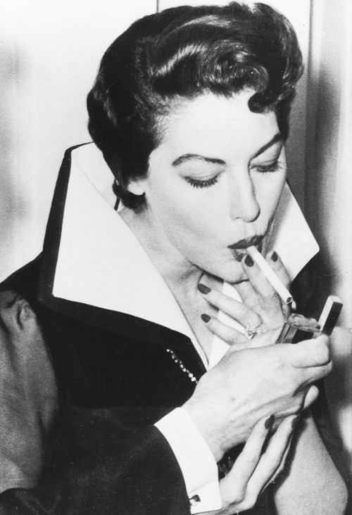 theniftyfifties:  Ava Gardner lights up at a party in her honour in Rome, 1957