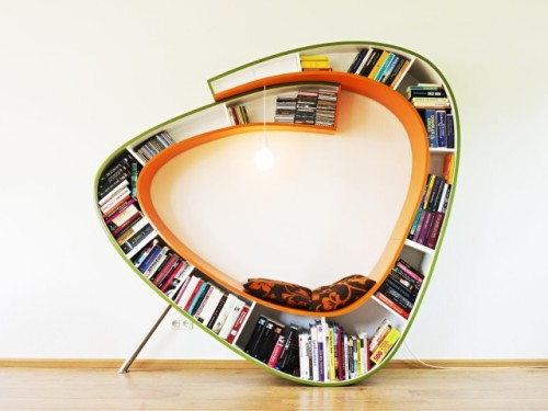 bookshelfporn:  Bookworm Chair Dutch design firm Atelier 010′s 'Bookworm' surrounds the reader with their books, wrapping around to create a seamless piece of furniture. Instead of having a separate reading chair and bookcase, this combines the two and also features a lamp suspended from the top, providing direct reading light.