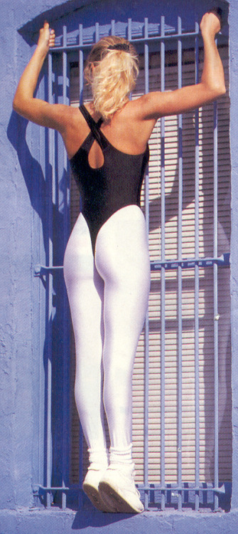Classic spandex combination: Black g-string leotard and white leggings