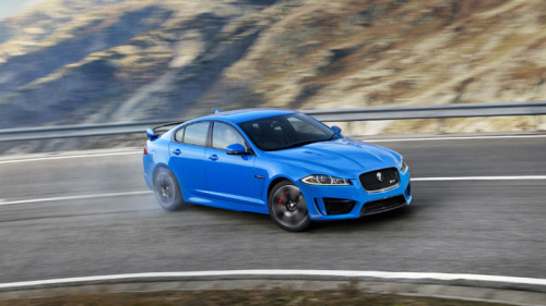 Jaguar unveils its M5 rival: the XFR-S  Let's talk power and torque. Power in the new car is up 40bhp over the XFR, and torque 41ft lbs, bringing the grand total to 550bhp and 501ft lbs from the 5.0-litre supercharged V8. Amazingly, this boost in power hasn't had an impact on the fuel consumption and emissions as they're still 24.4mpg and 270 g/km.  But numbers like this put it toe-to-toe with Stig's favourite sideways saloon, the BMW M5. The Jag will hit 62mph in just 4.4 seconds (just 0.1 seconds slower than the M5), and it will go a lot faster: the XFR-S is limited to 186mph, where the M5 has its reins pulled in at 155mph. The Jags eight-speed transmission comes packaged with tech developed for the impending F-Type called 'Quickshift'. Quickshift aims to get you the quickest and crispest shifts when you want them by anlaysing road conditions, throttle and steering input. If you're being a bit lairy, it'll throw cogs at you like Donkey Kong throwing barrels, but if you're being a bit more relaxed and gentle with the throttle it will change the shift to something a bit smoother and lower down the rev band. Frankly, if it's anything like the last car to get the R-S treatment from Jaguar Land Rover's specialist ETO division, the XKR-S, you'll be shifting hard. The fast XK is rightly lauded for its glorious noise, and in the XFR-S they've replaced the silencer from the standard car with an X-piece and near straight-through rear pipes. Expect that characteristic crackle on the overrun.  More at TopGear.com
