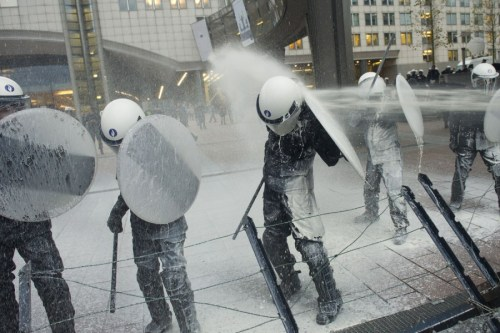 timelightbox:  Nov. 26, 2012. Police officers are sprayed with milk by European milk farmers during a demonstration outside the European Parliament in Brussels. (Photo: Geert Vanden Wijngaert—AP) From protests in Egypt and life in the aftermath of the Gaza conflict to Myanmar's refugee camps and volcanic lava spilling into the ocean in Hawaii, TIME presents the best pictures of the week. See more on LightBox.  The dairy deluge, engineered by the European Milk Board, is in protest of what the farmers claim are too-high quotas and fixed prices that are stifling their ability to maintain production. The EU sets a yearly milk production quota of 130 million metric tons, more than their member states can actually consume, a standard they plan to phase out come 2015.
