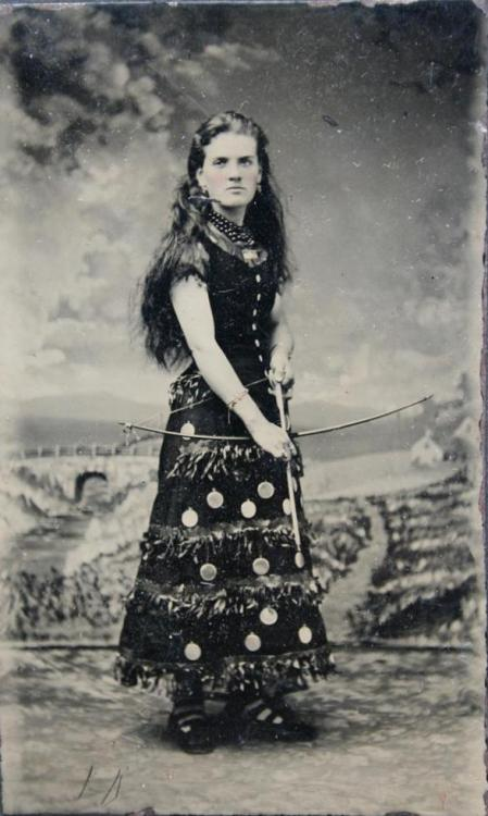 tuesday-johnson:  ca. 1860-80's, [tintype portrait of a woman in unusual costume, possibly for a Wild West show, with a bow and arrow] via Ebay