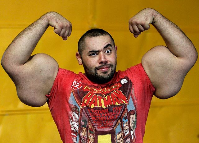 Moustafa Ismai, an Egyptian body builder has the world's biggest biceps and triceps, poses for a photo. (AP) GALLERY: Did You See That?