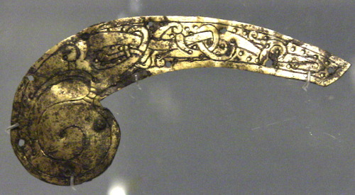 gilded copper alloy mount, decorated in Ringerike style, perhaps from a wooden chest, saddle, or piece of furniture, early 11th C.Museum of London