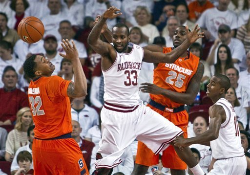 rknone:  Arkansas' Marshawn Powell (33) and Syracuse's DaJuan Coleman (32) and Rakeem Christmas (25) react to a deflected ball as Arkansas' B.J. Young, right, watches during the first half of an NCAA college basketball game in Fayetteville, Ark., Friday, Nov. 30, 2012. (AP Photo/Gareth Patterson) (via NCAAB - Photo Gallery - Yahoo! Sports)