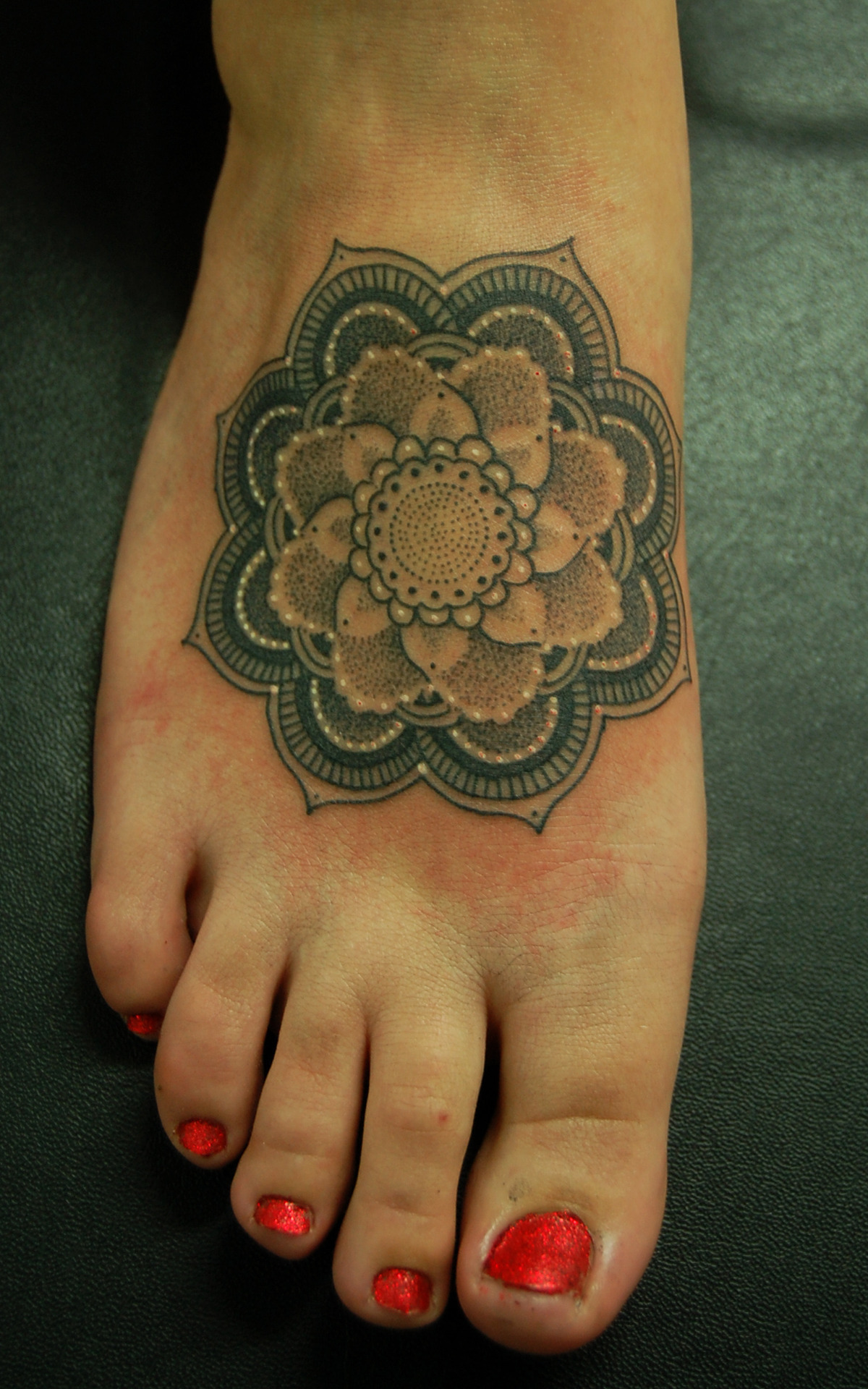 fuckyeahtattoos:  Mandala for Sammy. Tattooed by Dotwork Damian at Blue Dragon Tattoo, Brighton.