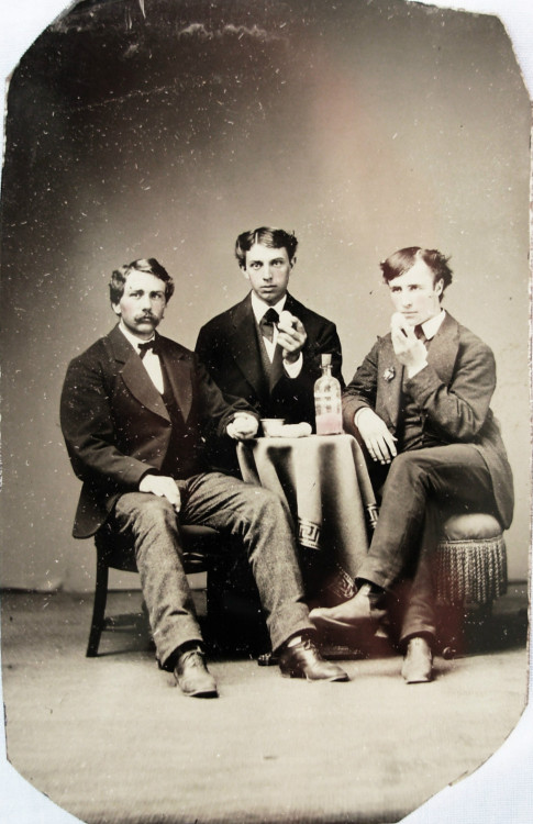 ca. 1870-1890's, [hand colored tintype portrait of three young men drinking a pink tinted liquid and eating what appear to be eggs] via Ebay