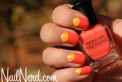 nailnerd-com:  Easy tutorial for painting orange wedge nail art on a base of Deborah Lippmann Girls Just Want To Have Fun